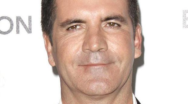 Simon Cowell was among the stars who signed the letter