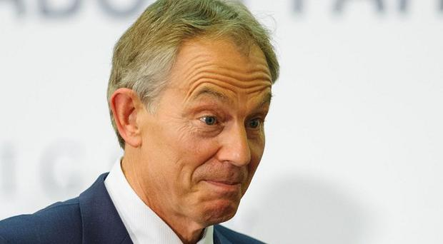 Former Prime Minister Tony Blair leaves the stage following the Westminster Faith Debate, in Westminster, central London