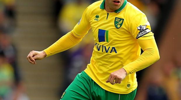 Norwich striker Grant Holt was left with the simplest of finishes