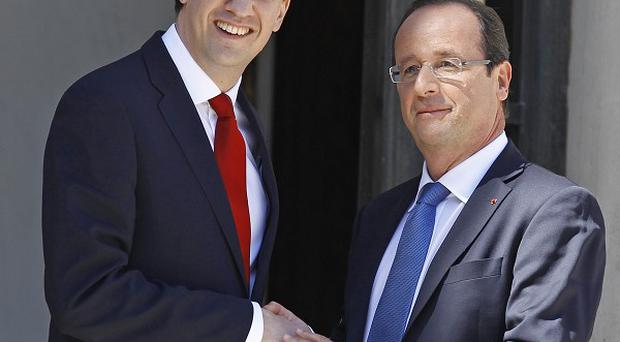 Labour Party leader Ed Miliband with French president Francois Hollande following their meeting at the Elysee Palace in Paris (AP)