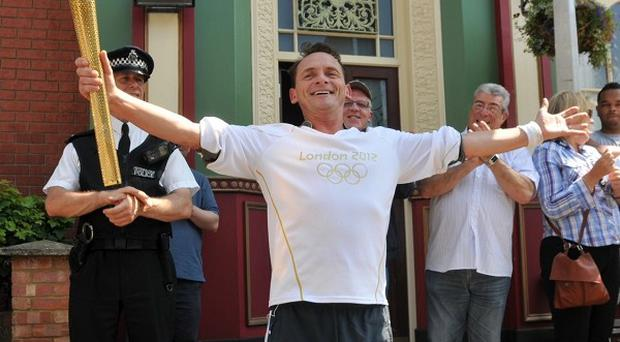 Billy Mitchell (Perry Fenwick) carried the Olympic Torch through Walford