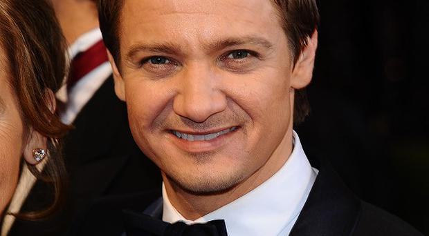 Jeremy Renner is said to be interested in playing Julian Assange