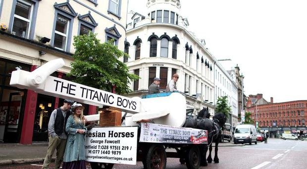 'The Titanic Boys' Play was promoted yesterday as a massive anchor resembling the Titanic's was carted around Belfast City Centre by a horse and carriage. Cast members Alfie Cunningham played by Brian Markey and Hannah played by Karen Hawthorne