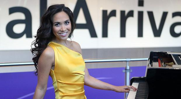 Classical musician and TV Presenter Myleene Klass performs for arriving passengers at Terminal 5 of Heathrow Airport. PRESS ASSOCIATION Photo. Picture date: Wednesday July 25, 2012 Photo credit should read: Steve Parsons/PA Wire