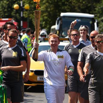 Rupert Grint is the latest celebrity to get his hands on the Olympic Torch