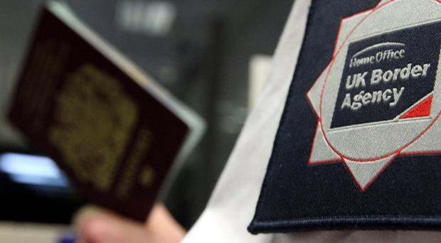 MPs have called for risk-based checks at the UK's borders to be brought back
