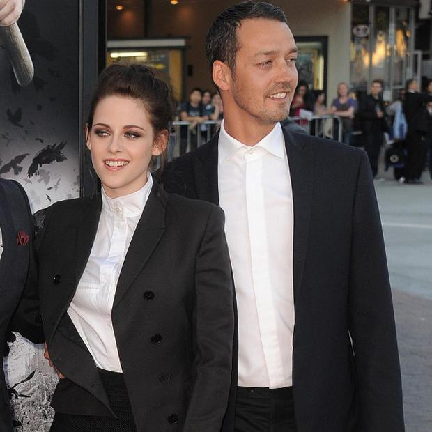 Actress Kristen Stewart and director Rupert Sanders have apologised publicly to their loved ones following reports they had an affair (AP)