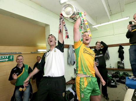 Donegal manager Jim McGuinness and captain Michael Murphy lift the Anglo Celt cup in the dressing room
