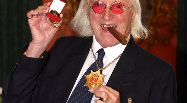 Sir Jimmy Savile's Jim'll Fix It Chair is expected to make thousands for charity at auction