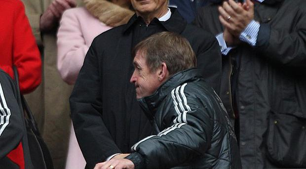 Kenny Dalglish (bottom) walks past Liverpool owner John W. Henry