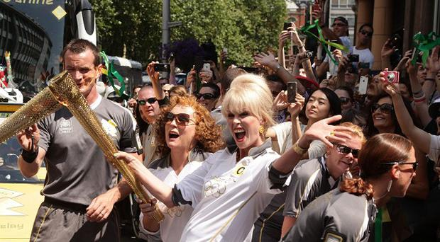 Joanna Lumley and Jennifer Saunders carried the Olympic Flame through Chelsea