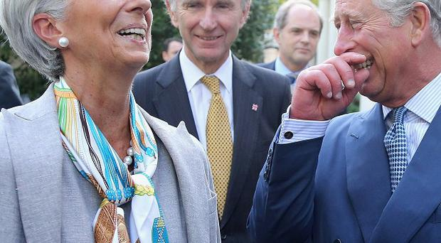 The Prince of Wales shares a joke with head of the IMF Christine Lagarde in the garden of Clarence House