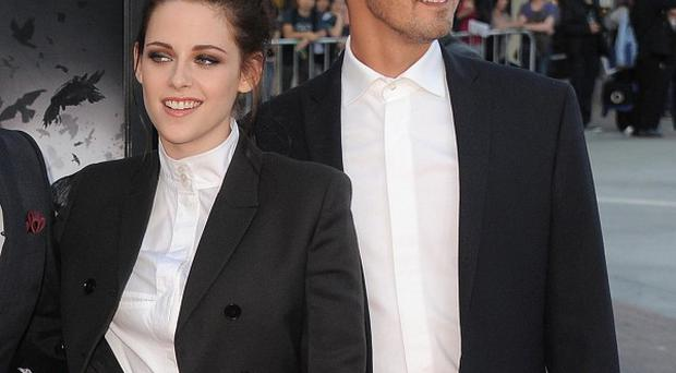 Kristen Stewart and director Rupert Sanders have apologised publicly to their loved ones following reports they had a brief, steamy affair (AP)