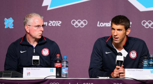 LONDON, ENGLAND - JULY 26: Michael Phelps (R) of the USA Swim Team and his coach Bob Bowman (L) of the USA speak during a press conference at the Main Press Center on July 26, 2012 in London, England. (Photo by Ryan Pierse/Getty Images)