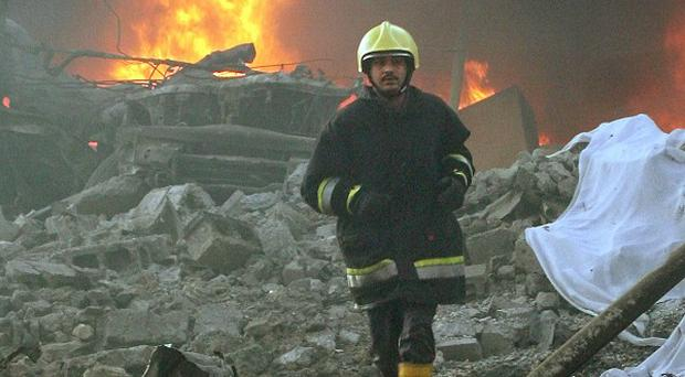 A 2005 photo of a firefighter after an attack on western contractors in central Baghdad (AP)