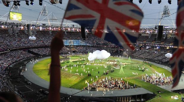 Union flags are waved during the opening ceremony