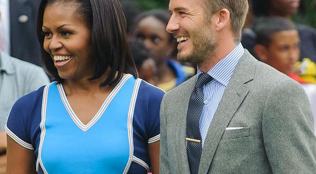US First Lady Michelle Obama and David Beckham at a Let's Move event, for the families of US Military personnel, at Winfield House in Regent's Park, central Londond
