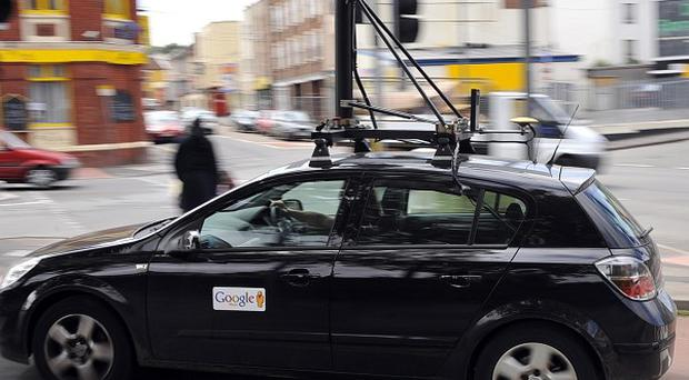 A Google mapping car with video and photography equipment mounted on top makes its way around the North Street area of Bedminster