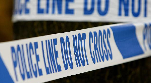 A Surrey Police officer shot a man in Woking on Wednesday