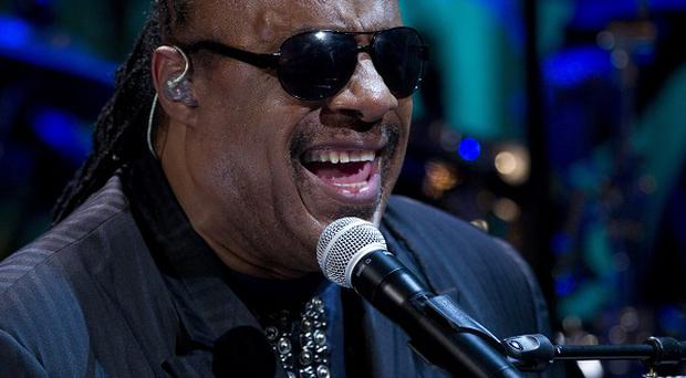 Two people have pleaded not guilty to trying to extort singer Stevie Wonder