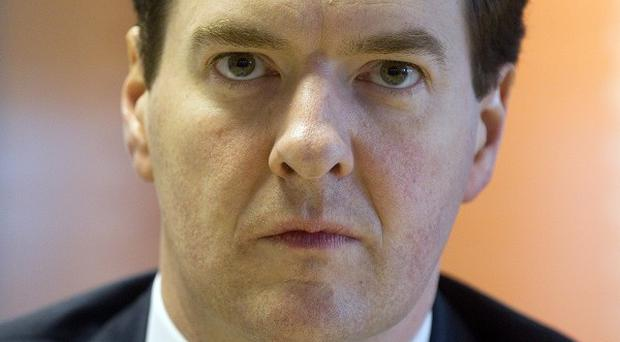 George Osborne has hailed confirmation of Britain's gold-plated AAA credit rating by a key agency
