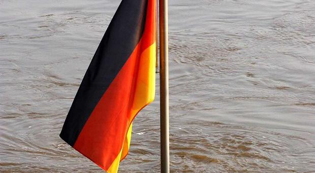 Germany has said it is suspending planned budget aid to Rwanda