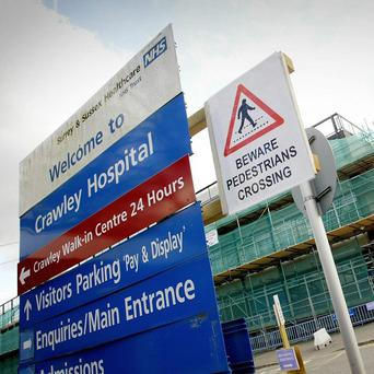 An elderly woman has died at a charity abseiling event at Crawley Hospital