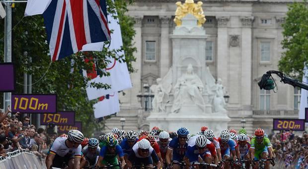 Thousands of people turned out to watch the men's road race in central London