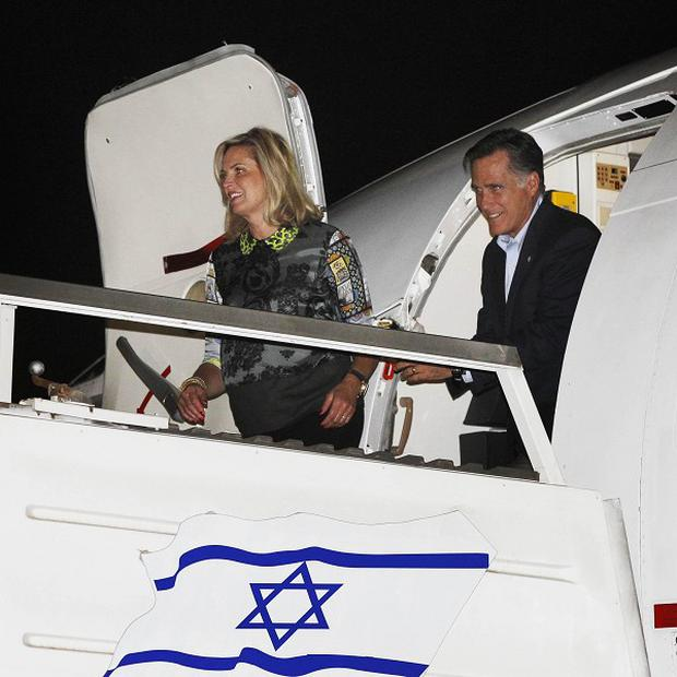 Republican presidential candidate Mitt Romney and wife Ann arrive in Tel Aviv (AP)