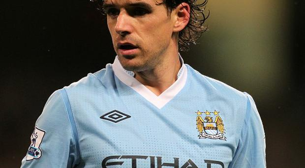 Injury-plagued midfielder Owen Hargreaves is hoping to earn a contract with QPR