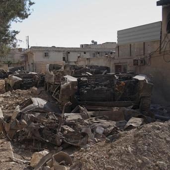Destroyed Syrian army armoured vehicles are seen in Aleppo (AP)