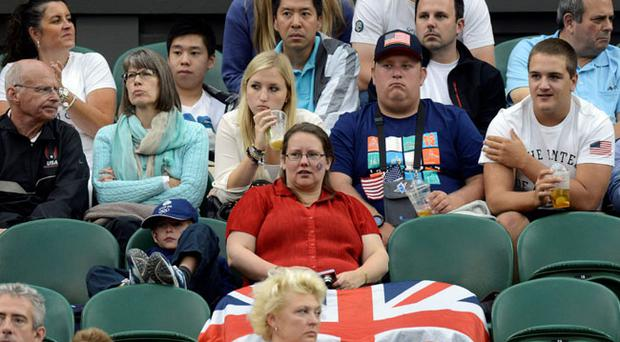 Empty seats on Centre Court during Great Britain's Andy Murray's First Round match in the Men's Singles at the Olympic Tennis Venue, Wimbledon