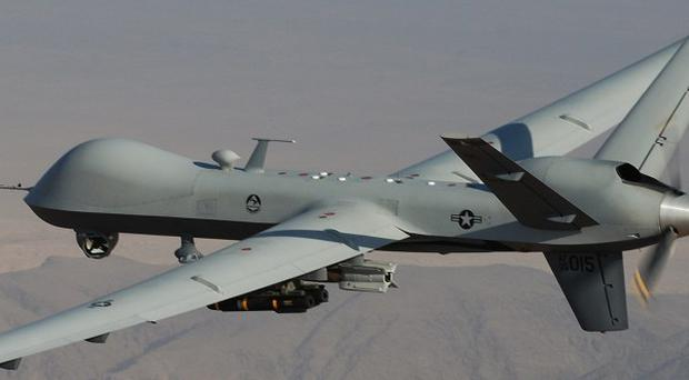 A suspected US missile strike has killed four people near the Afghan border