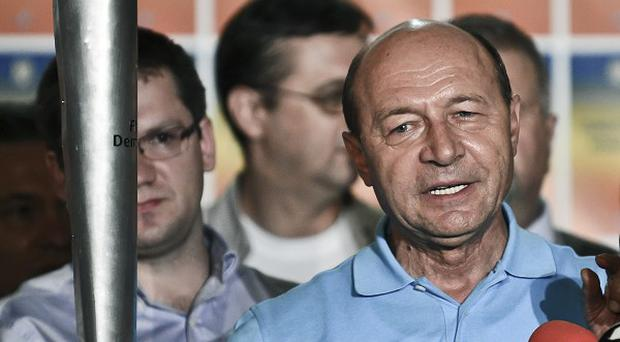 Romanian president Traian Basescu pledged to work towards reconciliation in the country (AP)
