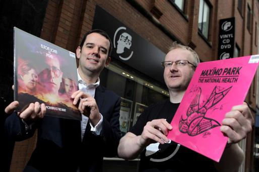 Lisney's Nicky Finnieston, left, marks the deal with Kenny Hutchinson of Head Records at the new store on Belfast's Ann Street