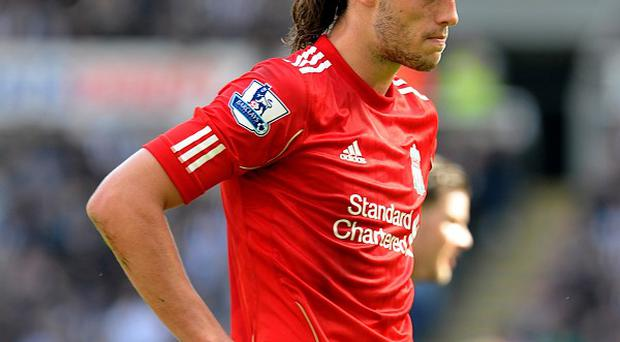 Andy Carroll has no desire to leave Liverpool, according to Brendan Rodgers