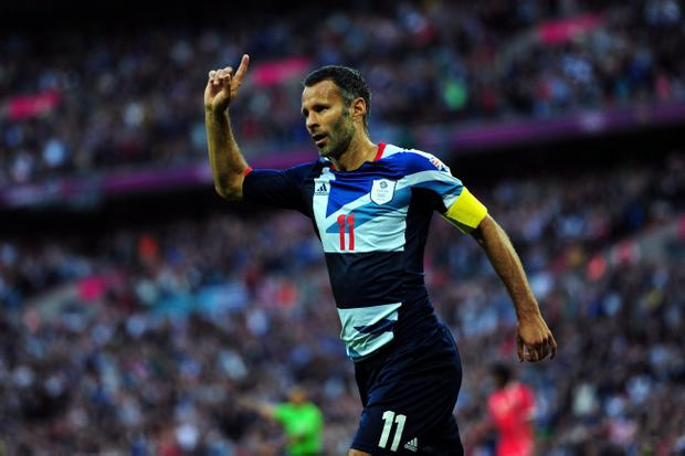Ryan Giggs of Great Britain celebrates scoring the opening goal during the Men's Football first round Group A Match between Great Britain and United Arab Emirates on Day 2 of the London 2012 Olympic Games at Wembley Stadium on July 29, 2012