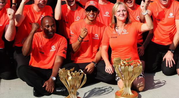 BUDAPEST, HUNGARY - JULY 29: Lewis Hamilton (C) of Great Britain and McLaren celebrates with his father Anthony Hamilton, his stepmother Linda Hamilton and his team mates in the paddock after winning the Hungarian Formula One Grand Prix at the Hungaroring on July 29, 2012 in Budapest, Hungary. (Photo by Mark Thompson/Getty Images)