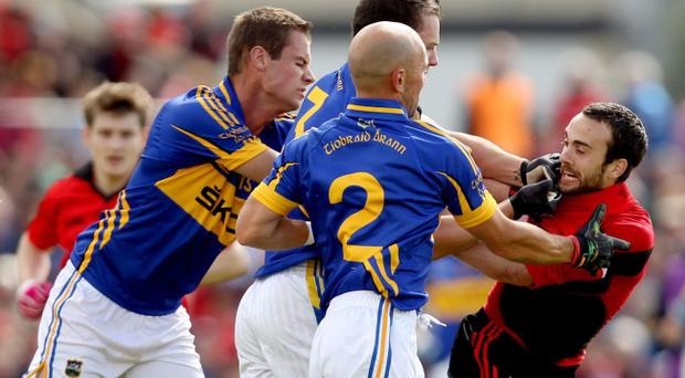 Tipperary's Alan Maloney, Paddy Codd and Andrew Morrissey clash with Conor Laverty of Down