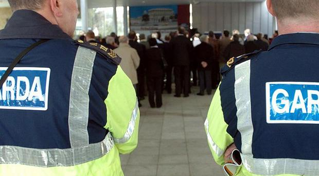 Gardai are investigating after a pensioner was assaulted and forced to go to a bank machine for cash
