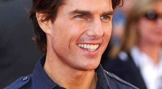 Tom Cruise spoke to snappers outside a Malibu eatery