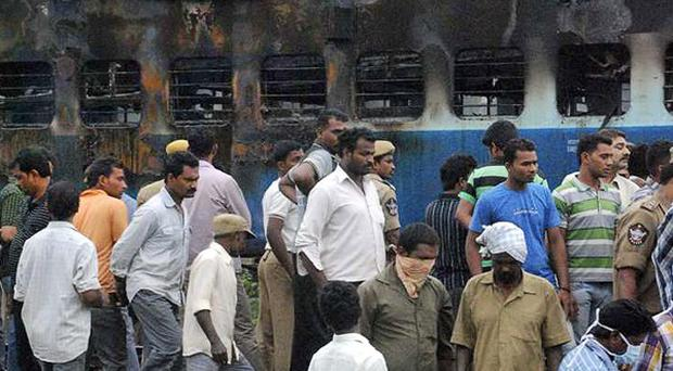 Dozens of people have been killed in a train fire in southern India (AP)