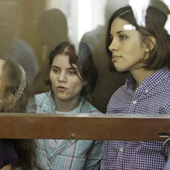The Russian punk group Pussy Riot in court facing charges over a protest in Moscow cathedral (AP)