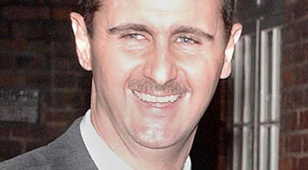 A Syrian diplomat has quit over the actions of president Bashar Assad