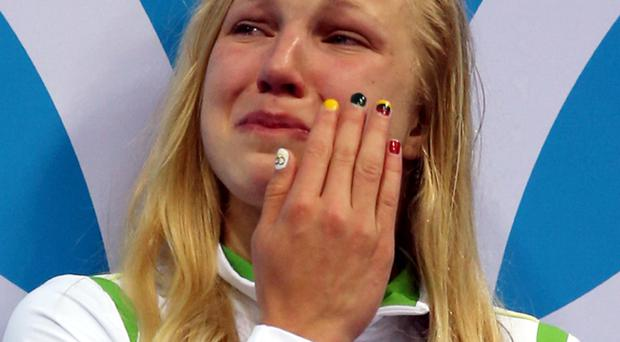 Ruta Meilutyte of Lithuania reacts as she receives her gold medal during the medal ceremony for the Women's 100m Breaststroke