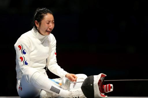 LONDON, ENGLAND - JULY 30: A Lam Shin of Korea crys after an issue with the match clock caused issues in her match against Britta Heidemann of Germany in the Women's Epee Individual Fencing Semifinals on Day 3 of the London 2012 Olympic Games at ExCeL on July 30, 2012 in London, England. Heidemann scored the final point with one second left on the clock to win against Shin. (Photo by Hannah Johnston/Getty Images)