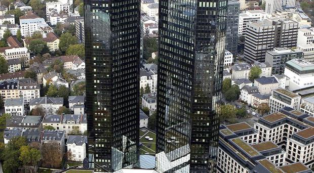 Deutsche Bank said the European sovereign debt crisis 'continues to weigh on investor confidence'(AP)