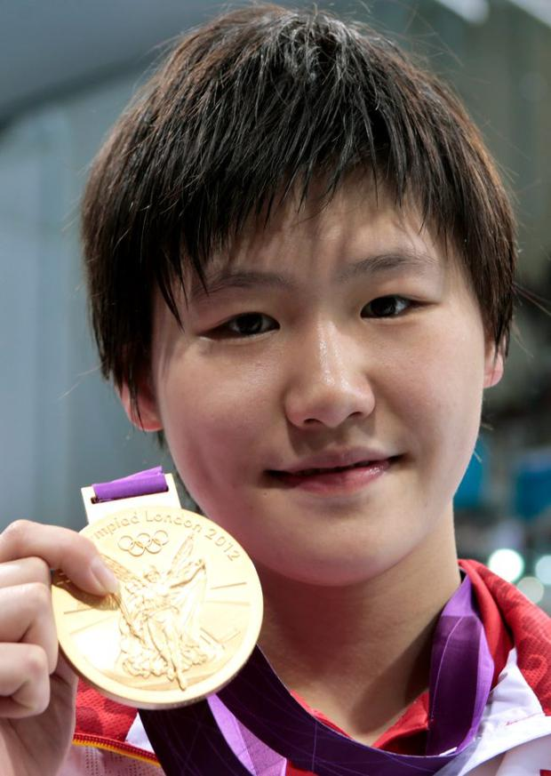 Shiwen Ye of China celebrates with her gold medal during the Medal Ceremony for the Women's 400m Individual Medley on Day 1 of the London 2012 Olympic Games at the Aquatics Centre on July 28, 2012
