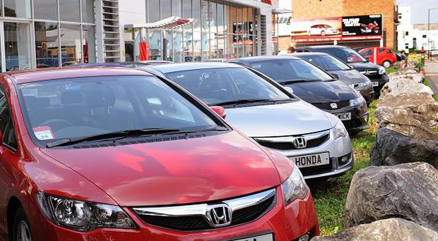 Car giant Honda said solid sales had offset the damage from the strong yen