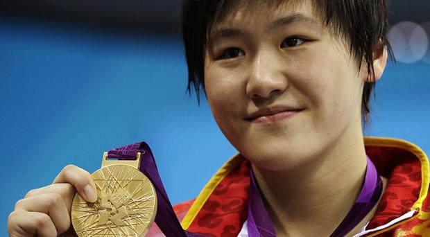 China's Ye Shiwen poses with her gold medal for the women's 200-metre individual medley swimming final (AP/Matt Slocum)
